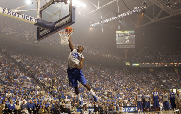 Kentucky basketball Freshman Patrick Patterson dunks in front of his team mates during the dunk  competition portion of Big Blue Madness at Rupp Arena in Lexington, Ky., on Friday, Oct. 12, 2007. (AP Photo/James Crisp)